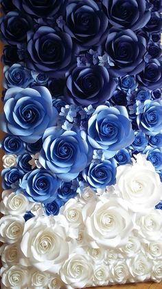 Blue ombré paper flowers in different sizes from 7 to 17 diameter. Use this large paper flowers as a wall for your bridal shower or wedding photographs, or to frame your top table. It may also be used for boutique front stores or any of your special events. This listing is for a 8ft