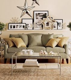 Picture ledge above a sofa! Good idea! Add a clock to the mix as well as pictures. Love.