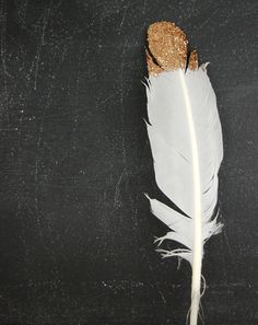 glittered feather...what a great idea for a 50th wedding anniversary party!