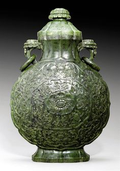 A SPINACH-GREEN JADE 'BUDDHIST EMBLEMS' MOONFLASK AND COVER -  QIANLONG PERIOD (1736-95)
