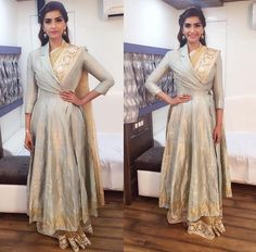 Sonam in a full length Angrakha jacket over a saree