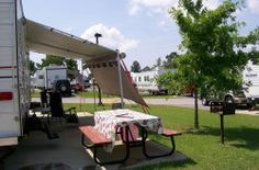 Gulf Breeze RV Resort Gulf Shores Al offers RV camping; hookups; cable TV; sewer; showers; indoor & outdoor swimming pool and rental cabins. wifi  and more.