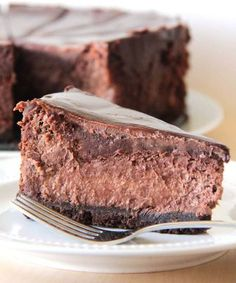 Death by chocolate cheesecake from The Baker Upstairs. Each layer is individually delicious... the crunchy, buttery cookie crust, the rich and moist cheesecake layer, and the silky smooth luscious ganache layer. Together, though, they're beyond amazing!