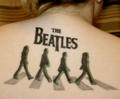the beatles tattoos --no words, just silhouette--