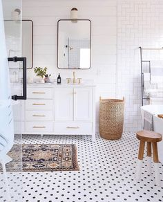 All white bathroom with minimal brass mirrors #smallspacesdecoratingmodern