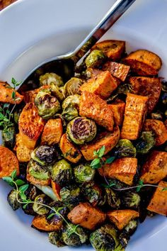 Roasted Sweet Potatoes and Brussels Sprouts - The Food Charlatan. It was so delicious! Roasted Sweet Potatoes and Brussels Sprouts - The Food Charlatan. It was so delicious! Side Dish Recipes, Veggie Recipes, Whole Food Recipes, Vegetarian Recipes, Cooking Recipes, Healthy Recipes, Recipes Dinner, Veggie Food, Vegetarian Grilling
