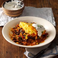 Easy Chicken Tamale Pie This is AWESOME! I didn't make it with the cornbread, I served it with rice instead. I used a whole onion, and a small can of diced green chilies in it also!