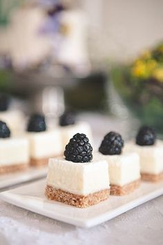 Blackberry gold and white wedding inspiration mini cheesecakes with blackberries