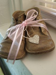 Baby Shoes with a pink ribbon
