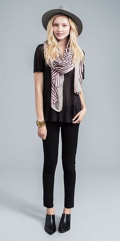 Cute, all in black with a darling scarf and hat.