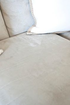 How to clean a microfiber couch with just rubbing alcohol, a sponge, a spray bottle, and a brush