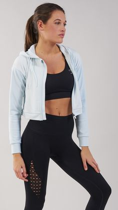 The Two Tone Cropped Hoodie features a relaxed, boxy fit with contrasting arm design. Coming soon in Ice Blue.