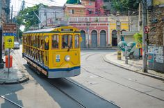 https://flic.kr/p/J7U34K | Tram at Santa Teresa | RIO DE JANEIRO - MARCH 07, 2016: Tourists ride the new version of the iconic bonde tram through the hillside neighborhood of Santa Teresa.