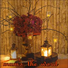 Centerpiece for big tables with Gold table cloth. Add plume feathers pearls.   Take gold mums and place them in the liquor bottles with paper sacks and incorporate jazz sheet music.