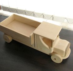 A wonderful toy for children (6+) Large truck of solid wood. The toy is natural, unpainted. ----The truck is made of lime wood. Hand made in Bulgaria. ----Dimension: Length: 40 cm, 15 3/4 Width: 14 cm, 5 1/2 Height: 14 cm, 5 1/2 Weight: 1100g