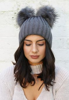 Womens knitted rib wool look hat with real fur pompom in burgundy red colour. Complete with turn up hem. Also available in dusky pink, cream & grey. Hat: 100% Acrylic, Trim: 100% Fox Fur.