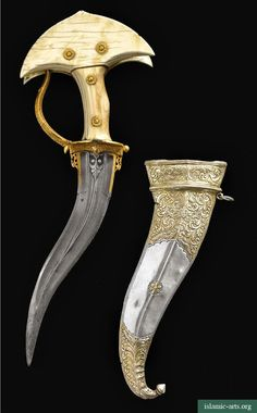 AN IVORY-HILTED DAGGER (KHANJARLI) AND SILVER SCABBARD, SOUTH INDIA The curved double-edged watered-steel blade chiselled with central ridge and yalis flanking the forte, curved steel knuckle guard terminating in a dragon's head, ivory hilt in four parts secured with gold rosette pins terminating in a bifurcated pommel, the silver scabbard engraved with designs of scrolling vegetation, birds and stylised flowers, with bud finial.