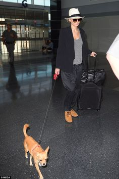 With her adorable pooch by her side, the Oscar-winning actress looked casually cool in a loose-fitting striped top under a black blazer with baggy satin black trousers.