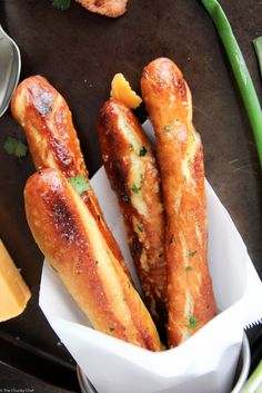 Baked Soft Pretzel Sticks - Soft, tender, buttery and brushed with a garlic and herb butter... these soft pretzel sticks from scratch taste amazingly good!