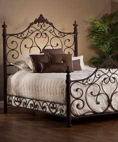 """$579.99 for Queen, $629.99 for king, Queen: 72""""H headboard & 43""""H footboard, Wrought iron. I like the look, but wouldn't be tucking my comforter in daily all around the base ironwork. Look what I found on #zulily! Brown Baremore Bed #zulilyfinds"""