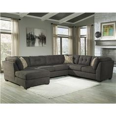 Stylish and comfortable, this sectional creates a place to gather that is instantly inviting. Plush backs with tufting meet with the shleter-style high arms for a cool look. Each piece of the sectional can also be used separately. The loveseat component includes a full-size memory foam sleeper mattress that pull outs to create a sleeping space for guests.  Three accent pillows with a colorful geometric design on one side complete the sectional group.
