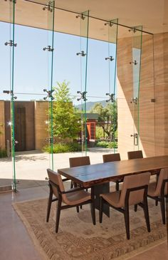 Rammed earth wall integrated w/ glass wall