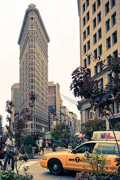A taxi drives by the Flatiron Building in #NYC.