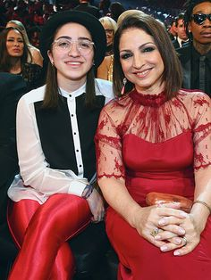 The Hottest Dates at the Grammys? Kids & Kin! | GLORIA ESTEFAN | Estefan, in red lace, complements mini-me 19-year-old daughter Emily's red-hot ensemble at the show, where the singer was nominated for best traditional pop vocal album and best instrumental arrangement accompanying vocalists.