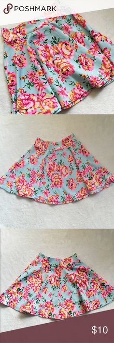 Blue Floral Circle Skirt with Bright Neon Flowers  Blue floral circle skater skirt by Charlotte Russe   Has bright neon pink and yellow flowers on a light blue background    Has elastic waist    Size small Charlotte Russe Skirts Circle & Skater