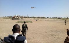 Mil Mi-8 attack helicopters flying to Fotoko Cameroon, 1 February 2015, after an operation in the nearby town of Gamboru, Nigeria, against Boko Haram.  (Photo Stéphane Yas / afp.com)