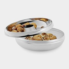 CASCARA nuts bowl:(Sven Hansen,2013) MoMA STORE |  put on the upper tray nuts.  put into the hole in the middle of the shell walnut. walnut shells fall to the bottom of the bowl.
