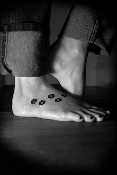 Paw print tattoo. This is the first foot tattoo I've ever seen that I actually love. Wouldn't copy it exactly from this girl, but it looks really awesome on her. Love.