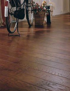 Tints of caramel, mocha and dark chocolate blend together in this #hardwood #flooring to create a unique look.