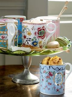 I love the idea of all the different mugs -- why should all of your dishes match when there are so many beautiful patterns to choose from.