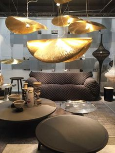 Milan Design Week: the Vogue Living day 2 diary : Gervasoni's feather-light brass pendants providing a beautiful contrast against the dark palatte.