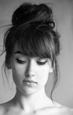 bangs with a top knot.