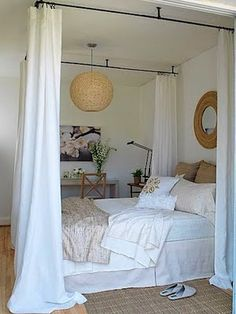 Love what a simple yet lush idea this is. Find any full-wrap or 3-sided shower curtain rod that you like and then pick from the multitude of curtain choices, colors and fabrics there are to create a secluded sanctuary.