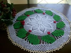 Idea for Christmas doily with green and white thread and Windsor doily pattern by P. Kristofferson