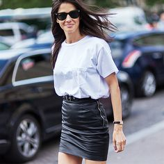 White t-shirt tucked into a black leather skirt