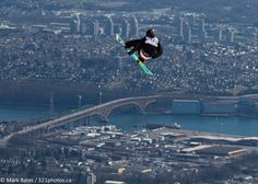 A snowboarder flies over the Second Narrows Bridge during a competition held on Grouse Mountain, Vancouver.