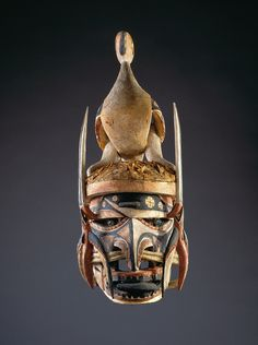 Northern New Ireland; Malagan Mask With Bird on Head, late 19th to early 20th century; wood, indigenous paints, red ochre, bark cloth, coconut and other fibers, rattan, and shell; 27 1/2 x 9 1/2 x 13 in. (70 x 24 x 33 cm); Saint Louis Art Museum, Gift of Morton D. May 176:1975a-c
