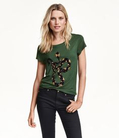 Short-sleeved jersey top with sequined embroidery at front and a gently rounded hem.