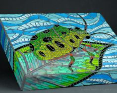 beautiful glass mosaic. love the way the design wraps around the sides as well.