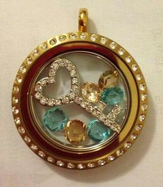 Gold Locket with Crystals and Key insert. Just click on the pic to order.