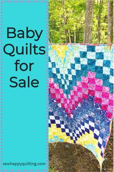 Sew Happy Quilting has many one of a kind baby quilts for sale. Our quilts are made to be used and loved and tossed in the laundry too. But at the same time, we love that they are very much cherished and most often get tucked away as an heirloom for future generations or hung on a wall to be admired for years to come. They make great baby shower gifts. #babyquilt #babyshowergift #babyblanket #giftforbaby #nurserydecor #babyroom #sewhappyquilting