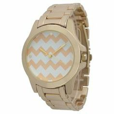 """The perfect accent for work apparel and casual weekend ensembles, this timeless boyfriend watch features a stainless steel band with a chevron-print face.    Product: WatchConstruction Material: Alloy, stainless steel, gold plate and glassColor: Peach and gold Features:  Push fold-over claspGlass has a protective mineral coatingRemovable links Chevron motifAccommodates: Battery - includedDimensions: 0.4"""" H x 9"""" W x 0.75"""" DCleaning and Care: Wipe clean"""