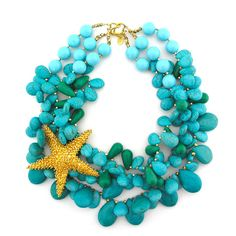 handmade strands of twisting turquoise magnesite teardrops, with a vintage golden sea star brooch.