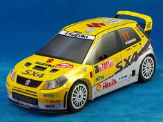 This paper car is a Suzuki WRC, created by eastern. The scale of the car paper model is The Suzuki is a compact car developed by Japanese aut Ferrari 360, Honda S2000, Chevrolet Corvette, Porsche 911, Paper Car, 3d Paper, Paper Toys, Lamborghini, Free Paper Models