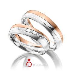 1 Paar Trauringe - Legierung: Rotgold 585/- Weißgold 585/- Breite: 5,50 - Höhe: 1,50 - Steinbesatz: 5 Brillanten zus. 0,1 ct. tw, vs (Ring 1 mit Steinbesatz, Ring 2 ohne Steinbesatz)
