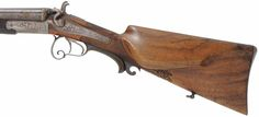 This view of the left hand lock and stock shows the large oval cheekpiece. Over a century old this shotgun is a fine example of old world craftsmanship. It would be a nice addition to any double gun collection.  Order it for a ten day visual inspection. You will be delighted. Else if it does not fit you, return it in unfired condition for same-day refund. Postage is your only risk, when you order any one-of-a-kind gun from Track, whether new, used, or antique.